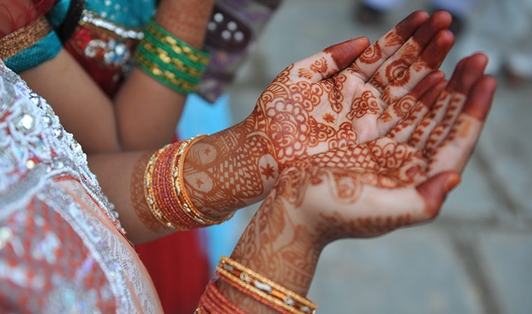 Eid al-Fitr: Hyderabad, India: An Indian Muslims girl holds out her decorated hands