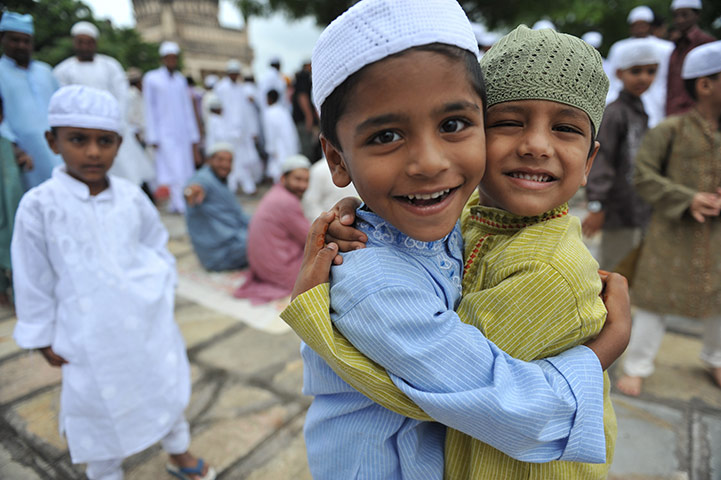 Eid al-Fitr: Hyderabad, India: Muslim children greet one another after Eid prayers