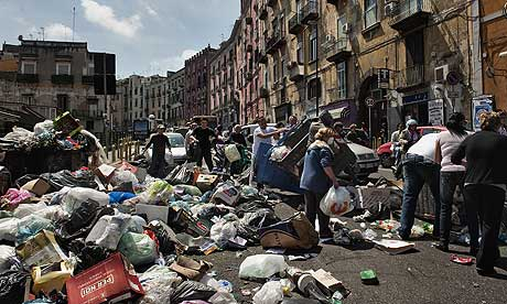 People cleaning rubbish in street in Naples