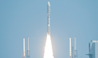 An Atlas V unmanned rocket carrying the Juno spacecraft launches successfully from Cape Canaveral