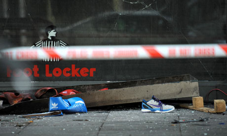 Looting Fueled By Vapid Consumerism Debris outside a Foot Loc 007