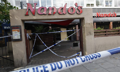 Nando's restaurant in Brixton, south London, is cordened off after being ransacked on August 8, 2011
