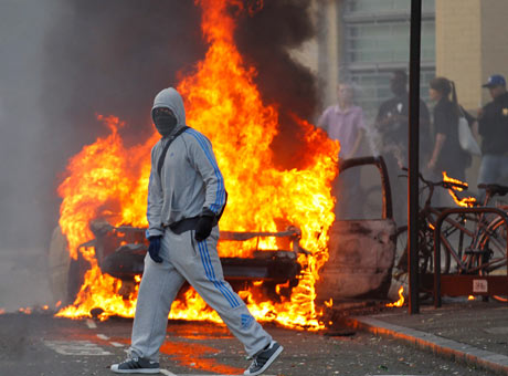 A masked rioter in Hackney