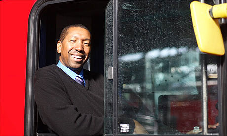 Bus driver leaning out of window smiling