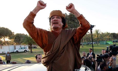 Muammar Gaddafi waving from a car