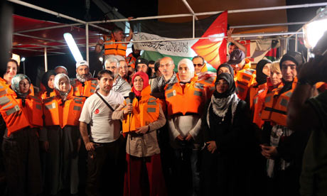 Pro-Palestinian activists hold a news conference on board the Turkish ship Mavi Marmara