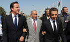 David Cameron, Libya's new interim leader Mustafa Abdel Jalil and Nicolas Sarkozy in Tripoli
