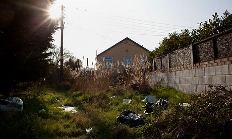 House with rubbish outside