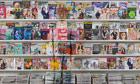 Magazine rack by Liu Bolin
