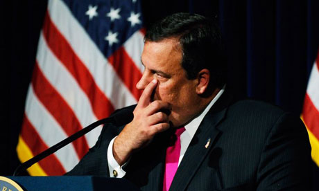 New Jersey Governor Chris Christie wipes a tear as he responds to a request to run for president