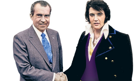 Richard Nixon shaking hands with Elvis Presley