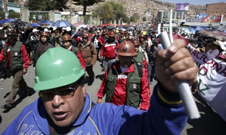 Bolivian miners protest in La Paz against a construction of a highway through the Amazon.  (Photo Courtesy of The Guardian)