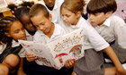 Pupils at the Hugh Myddleton primary school reading