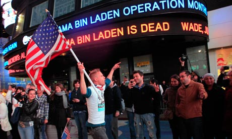 An American celebrates the death of Osama bin Laden in Times Square on 2 May