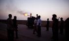 A Libyan rebel soldier fires a machine gun into the air