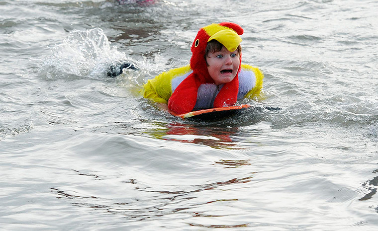 New Years day swimmers: Swimmers take to the water for the annual dip in the South Bay, Scarborough