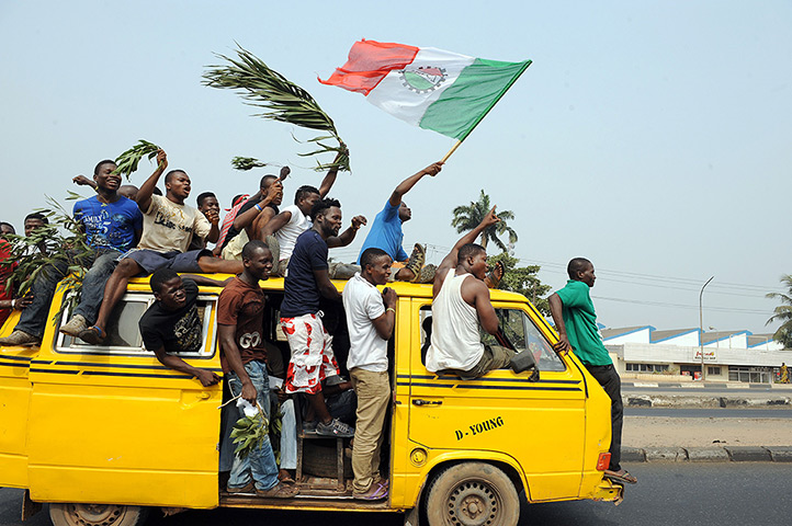 Nigeria fuel protests: A minibus carries protestors through Lagos