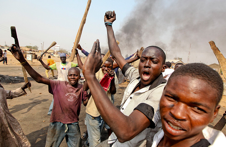 Nigeria fuel protests: Demonstrators gather at a barricade at Gwagwalada