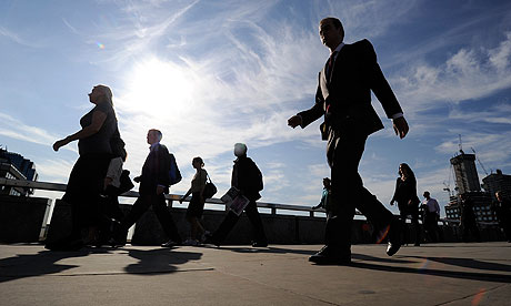 Workers cross London Bridge during the morning rush-hour