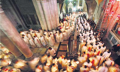 Catholic priests in the Church of the Holy Sepulchre in Jerusalem