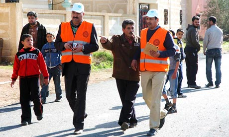 Handout photo of members from Arab League observers delegation visiting al-Msefra town near Deraa