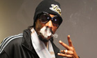 Snoop Dogg poses backstage after a performance