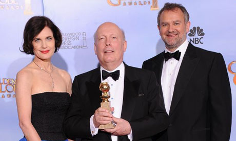 Downton Abbey writer Julian Fellowes, centre, with Elizabeth McGovern and Hugh Bonneville