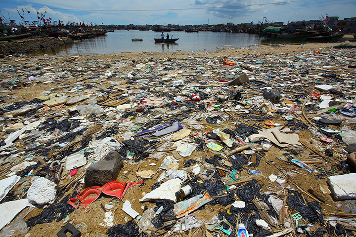 China environmental year: rubbish-strewn beach in Anquan village,  Hainan province