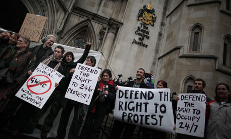 Supporters of Occupy London outside the Royal Courts of Justice on 18 January 2012.