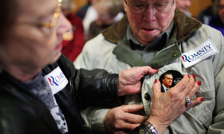 Romney supporters pin on badges