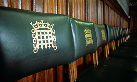 row of chairs in a reception room in the houses of parliament UK London