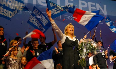 Marine Le Pen, the French far-right leader and National Front candidate for the presidential election, waves to supporters.