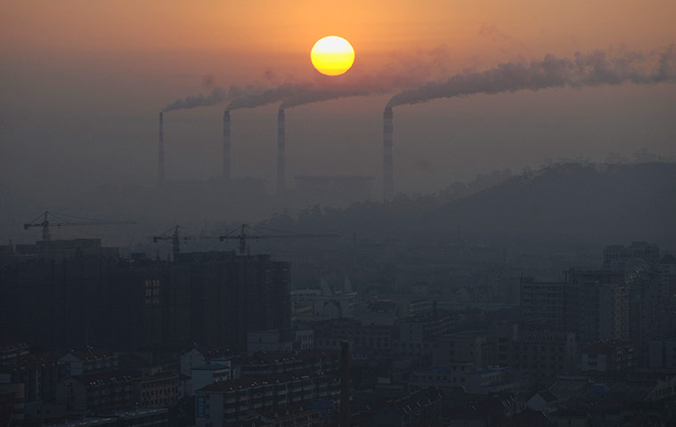 China environmental year:: Smoke billows from the chimneys of a power plant during sunrise in Jiaxing