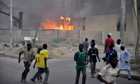 People run for safety during recent bomb attacks in Kano, which has been targeted by Boko Haram