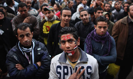 A young man gives the victory sign in Tahir Square, Cairo