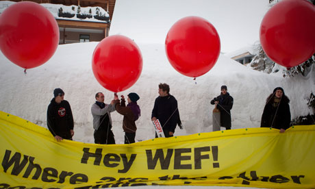 Protesters from the Occupy movement release a banner