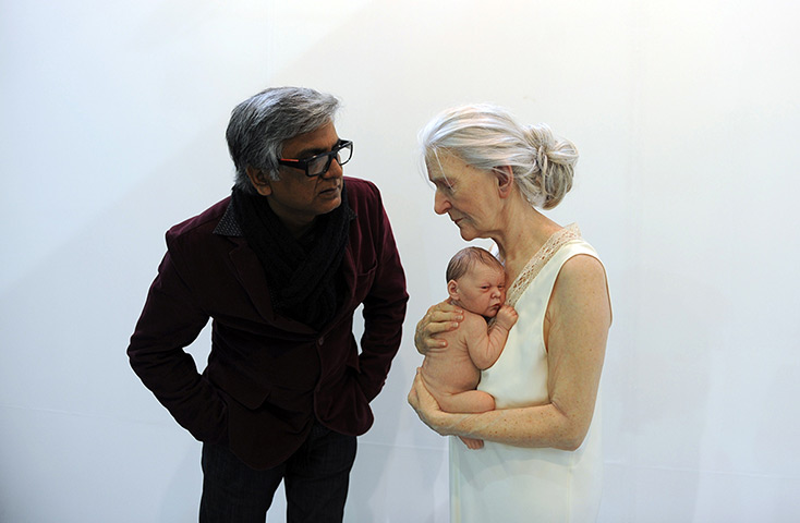 India art fair: A visitor, left, takes a close look at a sculpture by artist Sam Jinks