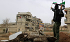 A Free Syrian Army fighter waves an independence flag in Saqba