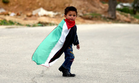 Child with a Palestinian flag