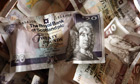 Royal Bank of Scotland bank notes. Labour says it will monitor bonuses for senior staff