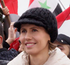 Asma al-Assad listens to a speech by her husband, President Bashar al-Assad