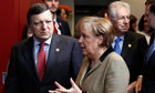Jos Manuel Barroso and Angela Merkel at the EU summit in Brussels
