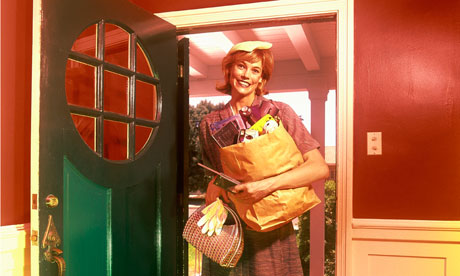 Retro woman at door with shopping bags