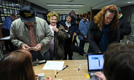 Voters register to cast their ballots during republican caucues at a school  in Des Moines, Iowa.