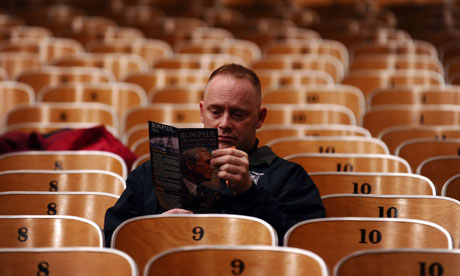 Iowa voter reads a Ron Paul campaign booklet