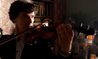 Benedict Cumberbatch as Sherlock plays the violin.