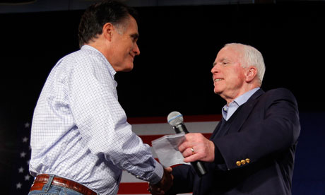 Mitt Romney shakes hands with John McCain at a campaign stop in Manchester