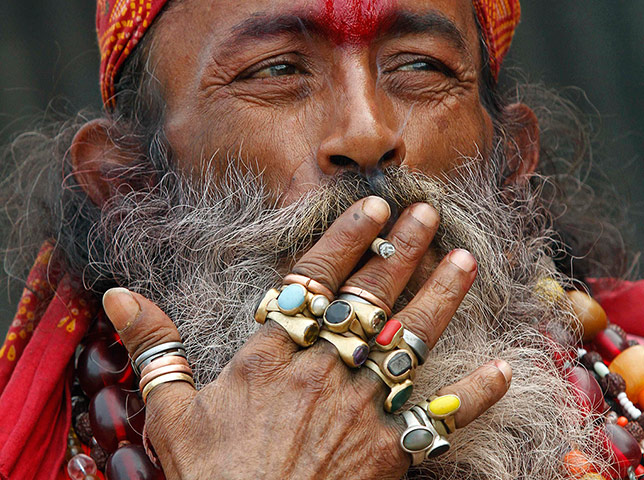 24 Hours: A Sadhu or Hindu ascetic smokes a bidi, a local cigarette, in Kolkata