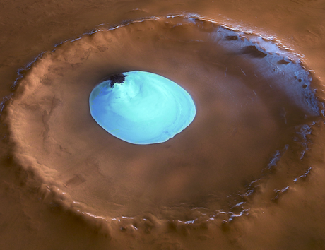 A patch of brilliant white water ice sitting in a Martian crater.