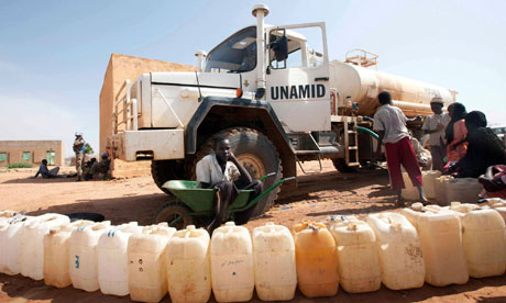 Boys from the Kassab camp for Internally Displaced Persons (IDP) collect water in Kutum